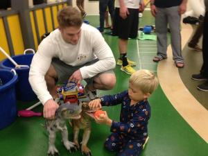 Michigan football players visited Chad and played dinosaurs with him.