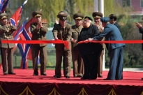 A nervous looking Kim appeared briefly to cut the ribbon, then scurried back to his limo and drove away.